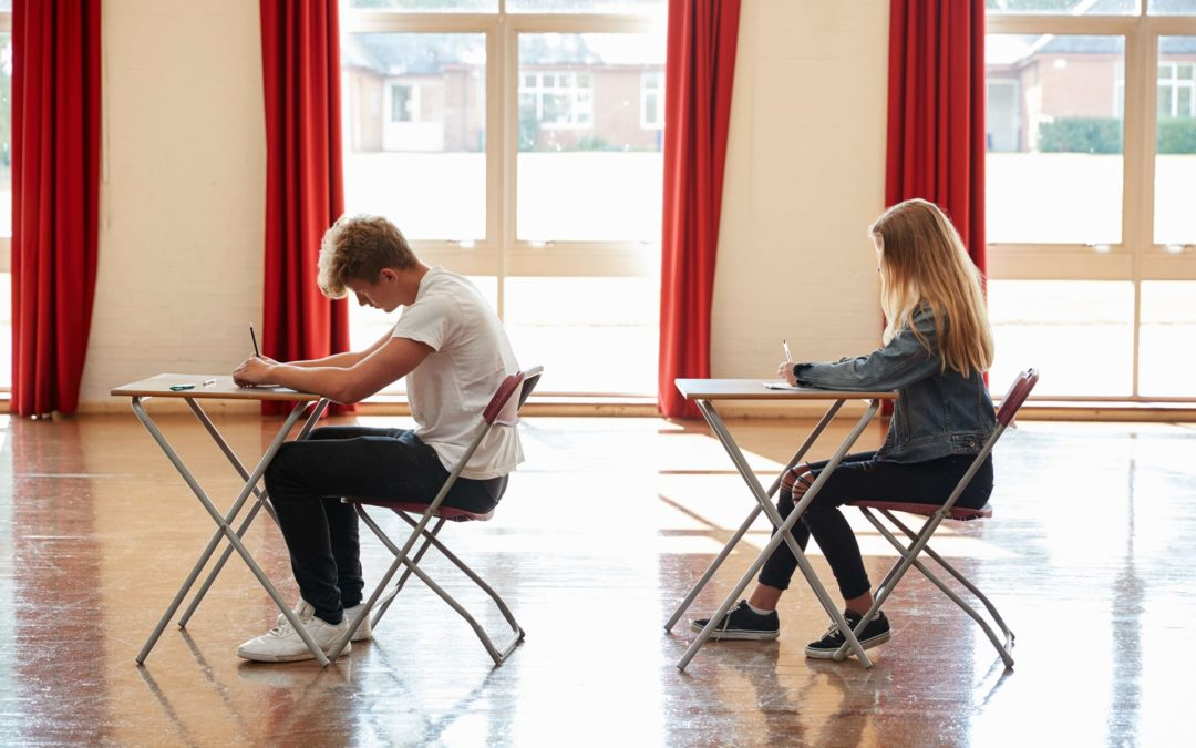 boy and girl in exam hall