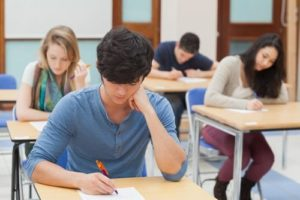 boy in blue top taking exams